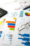 Graphs and Charts. On worktable with pen and glasses Royalty Free Stock Photo