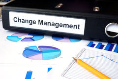 Graphs and file folder with label  Change Management. Stock Photo