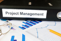 Graphs and file folder with label  Project Management. Royalty Free Stock Image