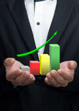 Graphs on the hands. Graphs on the hands of businessmen Royalty Free Stock Photo