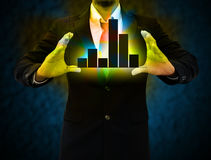Graphs on hands of businessmen. royalty free stock photo