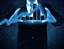 Graphs on the hands of businessmen Stock Photo