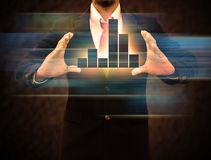 Graphs on the hands of businessmen. Stock Image