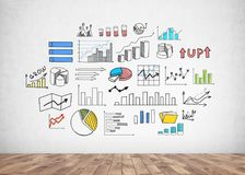 Graphs, icons and diagrams on concrete wall. Colorful and bright infographics with bar charts and diagrams, business growth icons drawn on a concrete wall in a Royalty Free Stock Image