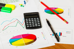 Graphs, pen and calculator close-up Stock Image