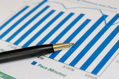Graphs and pen Stock Image