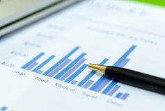 Graphs and pen Royalty Free Stock Photos