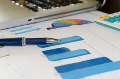 Graphs and pen Stock Photos