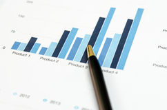 Graphs and pen Stock Photo