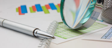 Graphs tables and documents. Laid on the table Royalty Free Stock Photo