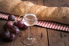 Grappa com uva e pão Foto de Stock Royalty Free