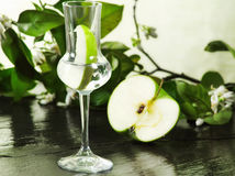 Grappa flavored with green apple Stock Photo
