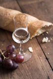 Grappa with Grape and Bread Stock Photo