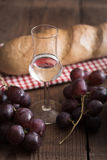 Grappa with Grape and Bread Royalty Free Stock Images