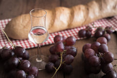 Grappa with Grape and Bread Royalty Free Stock Photos