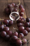 Grappa with Grape Royalty Free Stock Image