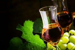 Grappa, grape vodka, selective focus. Grappa, italian grape vodka, strong drink, selective focus food still life stock photo