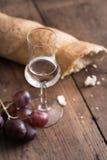 Grappa z winogronem i chlebem Zdjęcie Stock
