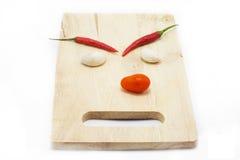 Grappig chillis en knoflook Stock Foto's