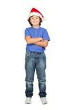 Grappig kind met de hoed van de Kerstman Stock Foto