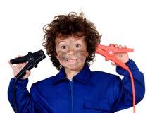 Grappig kind met een elektrisch probleem Ben carefull! stock afbeeldingen