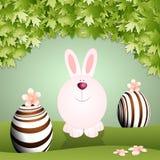 Grappig konijntje met chocoladeeieren stock illustratie