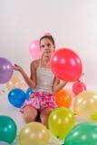 Grappig leuk meisje met baloons Stock Afbeelding