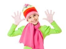 Grappig meisje in de winterkleren met grappenteken stock foto