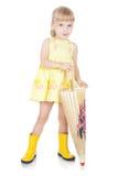 Grappig meisje in laarzen met paraplu Royalty-vrije Stock Fotografie