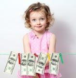 Meisje met geld stock afbeeldingen