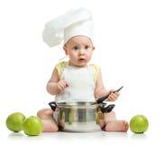 Grappige aanbiddelijke baby met groene appelen royalty-vrije stock foto