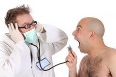 Grappige arts en patiënt Royalty-vrije Stock Afbeeldingen