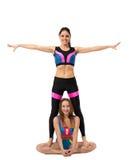 Grappige atletische die meisjes, op wit worden geïsoleerd Stock Foto