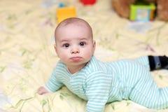 Grappige babyjongen Stock Foto