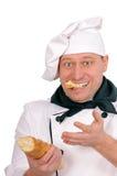 Grappige chef-kok met brood stock fotografie