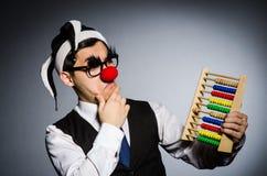 Grappige clown met telraam Stock Foto's