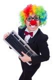 Grappige clown met toetsenbord Royalty-vrije Stock Foto's