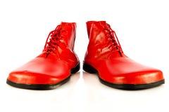 Grappige die schoenen op witte toebehoren worden geïsoleerd als achtergrond Royalty-vrije Stock Foto