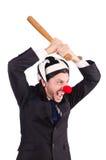 Grappige geïsoleerde clownzakenman Stock Foto's