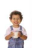 Grappige gezichtspeuter met glas melk stock afbeelding