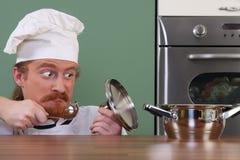 Grappige jonge chef-kok Royalty-vrije Stock Afbeelding