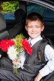 Grappige jongen met een boeket van bloemen Royalty-vrije Stock Fotografie