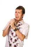 Grappige kerel met een microfoon Royalty-vrije Stock Afbeeldingen