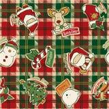 Grappige Kerstmiselementen met geruit Schots wollen stofachtergrond Royalty-vrije Stock Foto's