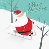 Grappige Kerstmisprentbriefkaar met het sledging van de Kerstman Royalty-vrije Stock Afbeeldingen