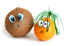 Grappige kokosnoot en sinaasappel Royalty-vrije Stock Afbeeldingen
