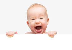 Grappige leuke geïsoleerde baby met witte lege banner Royalty-vrije Stock Foto's