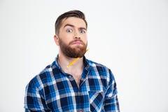 Grappige mens met potlood in baard royalty-vrije stock afbeeldingen