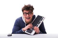 Grappige nerdmens die die aan computer werken op wit wordt geïsoleerd royalty-vrije stock afbeeldingen