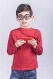 Grappige nerdy weinig jongen royalty-vrije stock foto